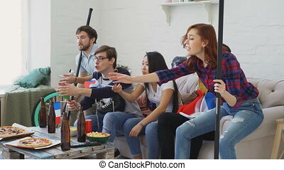 Multi ethnic group of friends sports fans with French...