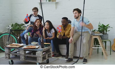 Multi ethnic group of friends sports fans with Norwegian...