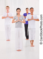 Multi ethnic group of happy people doing yoga