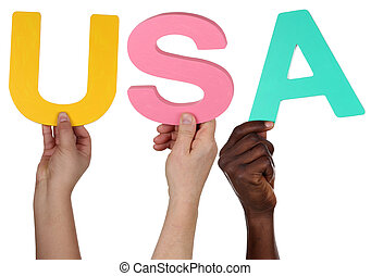 Multi ethnic group of people holding the word USA