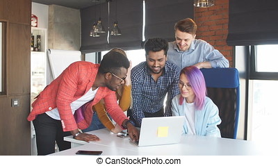 Multi-Ethnic Group of People Working Together indoors -...