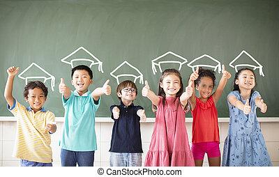 Multi-ethnic group of school children standing in classroom