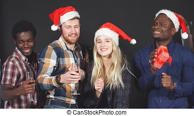 Multi ethnic group of students at Christmas party. - Multi...
