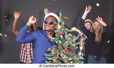 Multi ethnic group of students at Christmas party, slow...