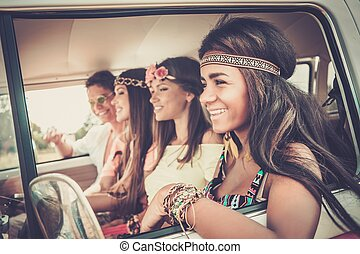 Multi-ethnic hippie friends on a road trip