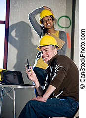Multi-ethnic male and female construction workers