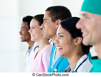 Multi-ethnic medical team standing in a line isolated on a...