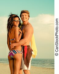 Multi ethnic young couple on a beach