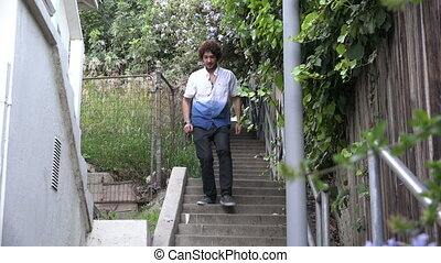 Multi-ethnic young man on an outdoor staircase - Handsome...
