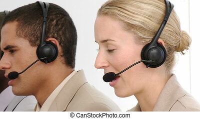 Multi-etnic business team working in a call centre in a...