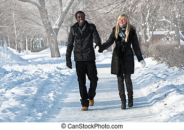 Multi-etnic couple - Romantic multi-etnic couple is walking...