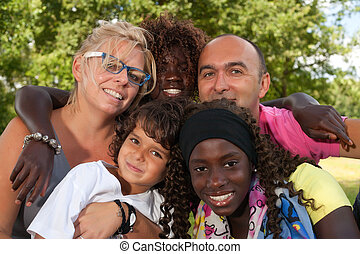 Multi etnic family - Happy multicultural family having a...