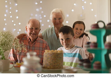 Multi-generation family celebrating birthday of grandson