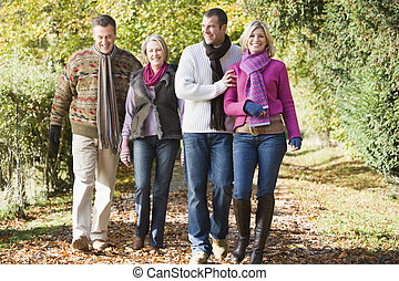 Multi-generation family enjoying autumn walk -...