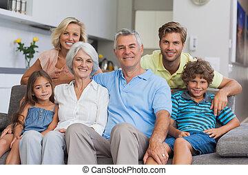 Multi-generation family posing in the living room