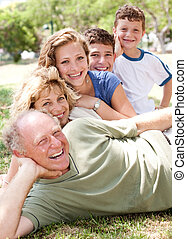 Multi-generation family realxing in park