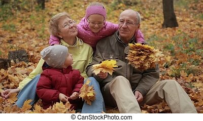 Multi generation family relaxing in autumn park - Happy...