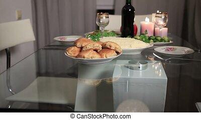 Multi generation family serving Thanksgiving table - Multi...