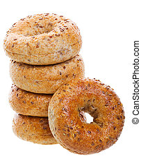 A stack of golden brown, multi-grain bagels. Shot on white background.