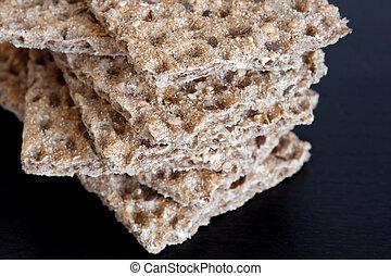 Multi-grain crisp bread on dark background - Healthy snack, ...