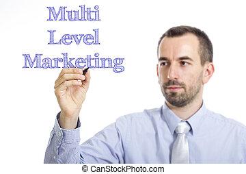 Multi Level Marketing MLM - Young businessman writing blue...