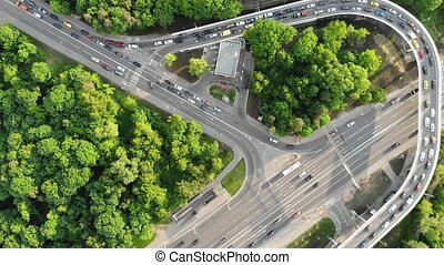 multi-level traffic interchange with jam on upper road -...