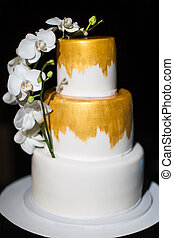 Multi level wedding cake with with white orchids