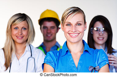 Multi-profession - Doctor, businesswoman, engineer and scientist smiling at the camera