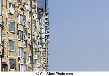 Multi-storey apartment on a background of blue sky