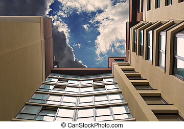 Multi-storey building on the background of the sky with clouds.