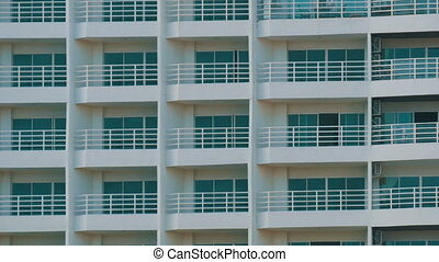 Multi-storey building with balconies and things that hang...