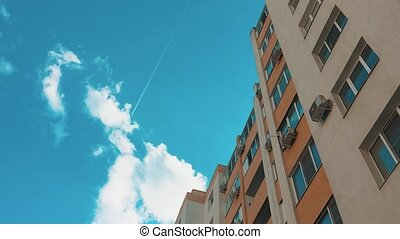 multi-storey house with air conditioning against the blue ...