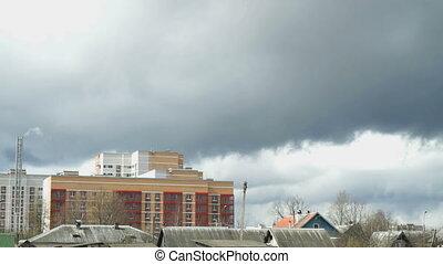 Multi-storey residential building. Dark sky, storm