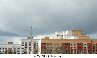 Multi-storey residential building. Thunderstorm -...