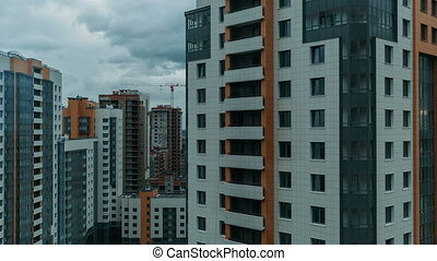 Multi-storey residential buildings close-up timelapse