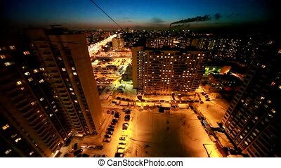 multi-storeyed buildings and street illumination at night