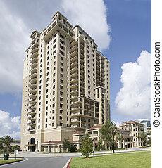 multi story luxury condos - pastel beige luxury condos with...