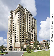 multi story luxury condos - pastel beige luxury condos with...