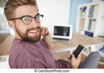 Multi tasking man in home office