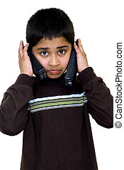 Multi tasking Series - A kid holding 2 phones and talking to...