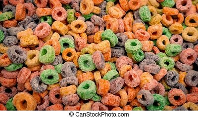 Multicolor Cereal Hoops - Colorful cereal hoops turning...