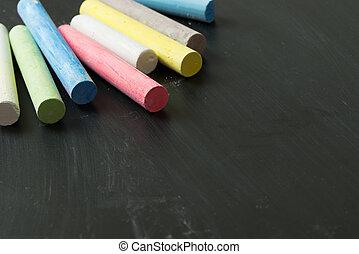 Multicolor chalk on chalkboard