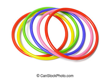 multicolor plastic bangles arranged on white background