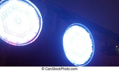 multicolor spotlight, light music while dancing, concert -...