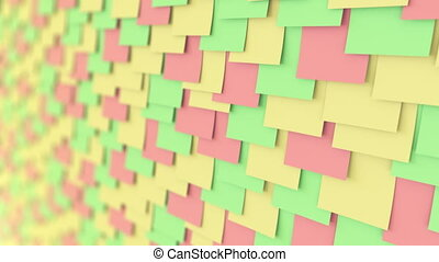 Multicolor stickers on the wall. Office paper work or memo concepts. 4K seamless loop close up dolly clip, shallow focus