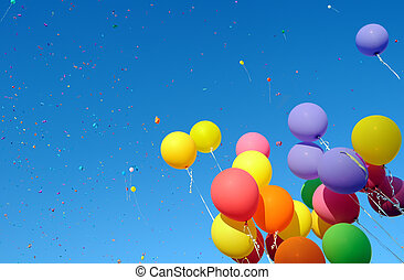 multicolored balloons and confetti