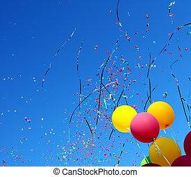 multicolored balloons and confetti in the city festival #10