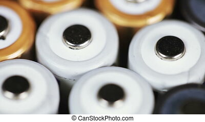Multicolored batteries - On white surface rotates group...