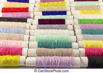 Multicolored bobbins of thread