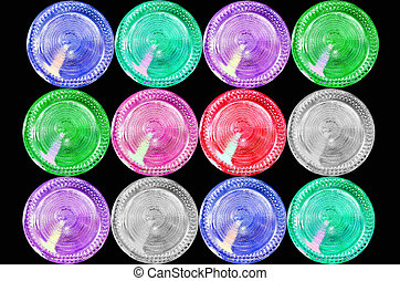 Multicolored Bottom of a glass bottle on black background